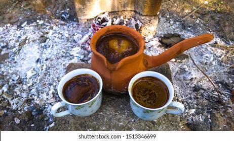 Hot coffee Turkish Coffee Cup and Earthenware Coffee Pot on Embers