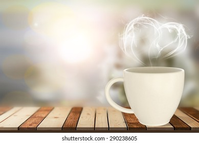 hot coffee in white cup on wood table with vintage blurred background.Hot steam in heart shape