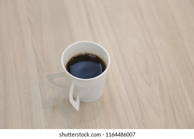 hot coffee in white paper cup