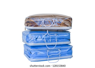 Hot and comfortable duvets in bag on white background
