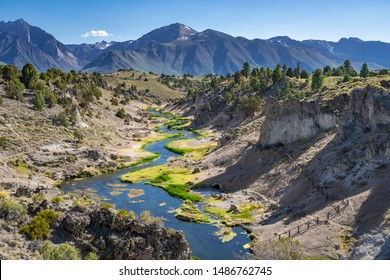 Hot Creek in Mammoth Lakes California. Natural hot springs in the eastern sierras. Must see vacation spots in California. Nature travel. Vivid landscape with mountains and river.