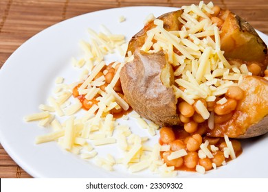 Hot and crispy baked potato stuffed with baked beans and cheddar cheese