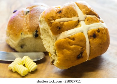 Hot cross bun made from rich yeast dough of flour, milk, sugar, butter, eggs, currants & spices. Usually eaten Good Friday, they are marked on top with a cross