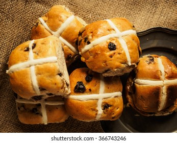 Hot cross buns on a rustic background shot from above
