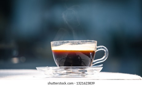 hot cup of black coffee on table