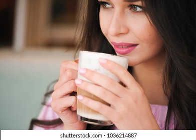hot cup of coffee or cappuccino in hands