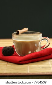 A hot cup of coffee and chocolate for dessert