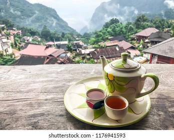 Hot cup tea after raining at Pha Hi village