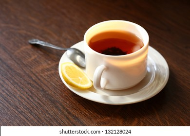 Hot cup of tea and lemon. Healthy morning breakfast