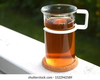 Hot Cup of Tea on Verandah Garden Outside Copyspace Shallow DOF