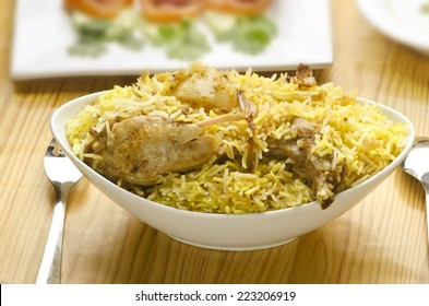 Hot delicious chicken biryani with salad and rita