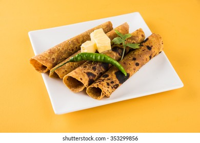 Hot delicious paratha roll with butter and tomato sauce