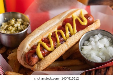 hot dog in basket with draft beer