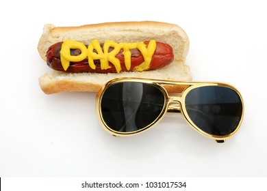 Hot Dog in bun with the word PARTY in yellow mustard with Gold Elvis Style Glasses on white. Its Party Time!