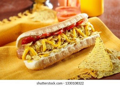 Hot dog with corn chips. Junk food