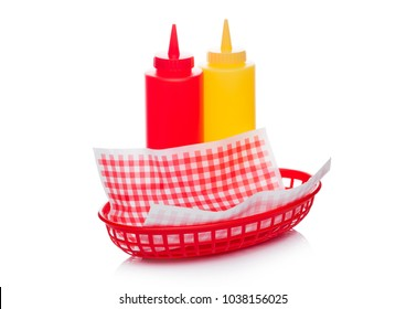 Hot dog fast food basket with ketchup and mustard and red paper on white background