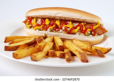 Hot dog with french fries on white plate