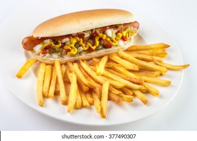 Hot dog and french fries on white plate