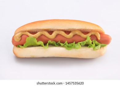 hot dog with lettuce and mustard