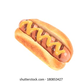Hot dog with mustard. Isolated on a white background.