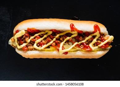 hot dog on the black background