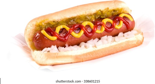 hot dog with pickle relish, onions, and swirled ketchup and mustard - Isolated