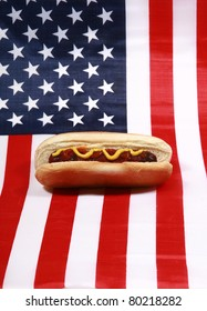 Hot Dog! A pipping hot Hot Dog in a bun with yellow mustard american flag. The perfect image for all your Hot Dog photo needs.