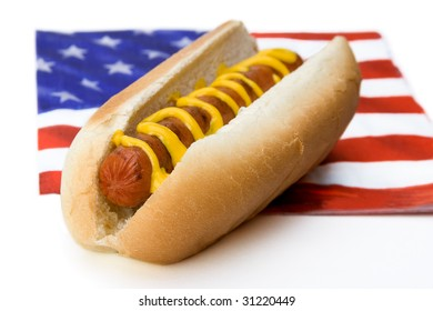 A hot dog sits on an American flag napkin. Great for Memorial Day or Fourth of July.