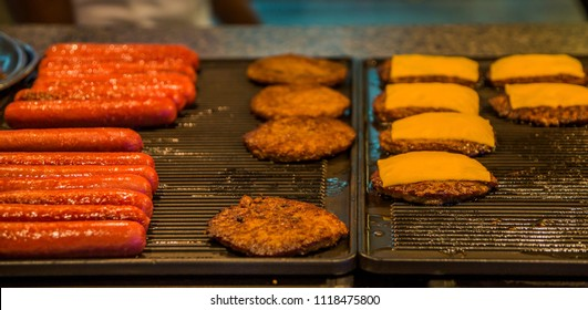 Hot Dogs and Cheeseburgers on a Grill
