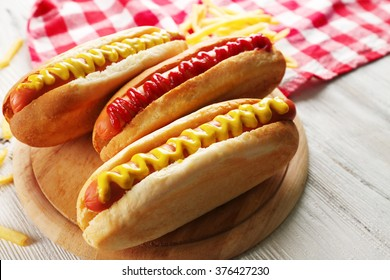 Hot dogs with fried potatoes closeup