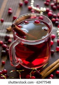 Hot drink with cranberries and cinnamon