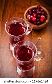 Hot drink with cranberries on white