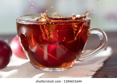 Hot drink. Hot fruit tea in with plums.