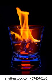 hot drink shots in bar on color abstract background