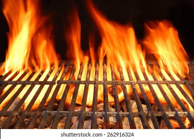 Hot Empty Barbecue Charcoal Grill Ready To Prepare Food With Flames Of  Fire On Black Background. Summer Party or Picnic Outdoor Cookout Scene