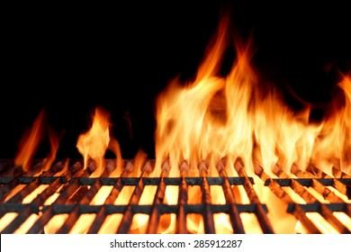Hot Empty Clean Charcoal BBQ Grill With Vibrant Flames On The Black Background. Cookout Concept.