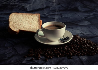 Hot espresso coffee with bread on dark background.