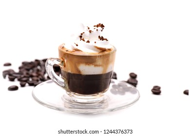 hot Espresso Con Panna coffy in a clear glass on a white background with coffee beans.in studio.