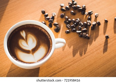 Hot espresso cup with coffee bean.