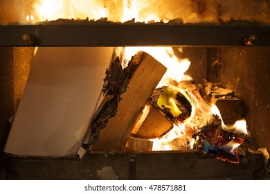Hot Fire in the fireplace, burning wood and paper