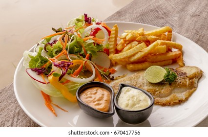 Hot Fish Steak on wooden table