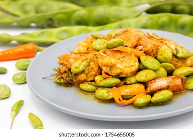 Hot and spicy Thai food, Fried curry with shrimps and Sato, Close up of Sato fried with shrimp spicy, Stir-fried stink bitter bean seeds (Parkia speciosa) with shrimp and chili.