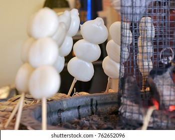 Hot fresh charcoal grilled white dango ball on skewer. Famous traditional japanese dessert made from rice flour. Popular among tourist in winter season.