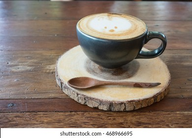 hot fresh coffee in white cup on wooden table spoon saucer rabbit print cappuccino coffee mocha coffee espresso coffee latte coffee