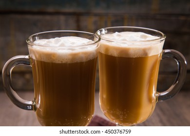 hot fresh coffee with white marshmallow in glass cup - Shutterstock ID 450376759