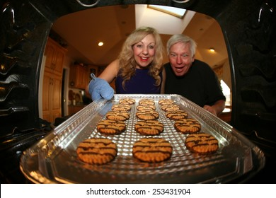 Hot and Fresh COOKIES right from the oven!  A lady bakes cookies for a charity bake sale to help raise money for a Homeless Cats.