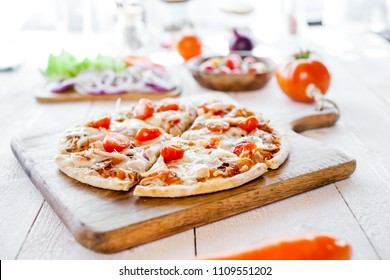 hot fresh homemade traditional italian pizza on wooden table. wallpaper for pizzeria and cooking food concept. closeup