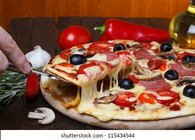hot fresh pizza with melting cheese on lifter