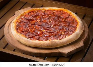 hot fresh pizza on a wooden table