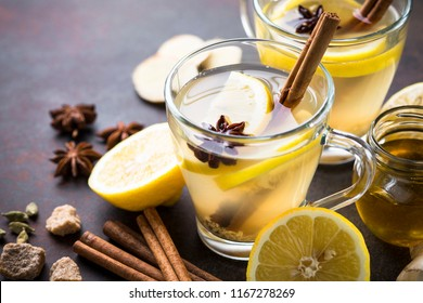 Hot Ginger tea in glass mug with lemon, honey and spices. Healing tea.